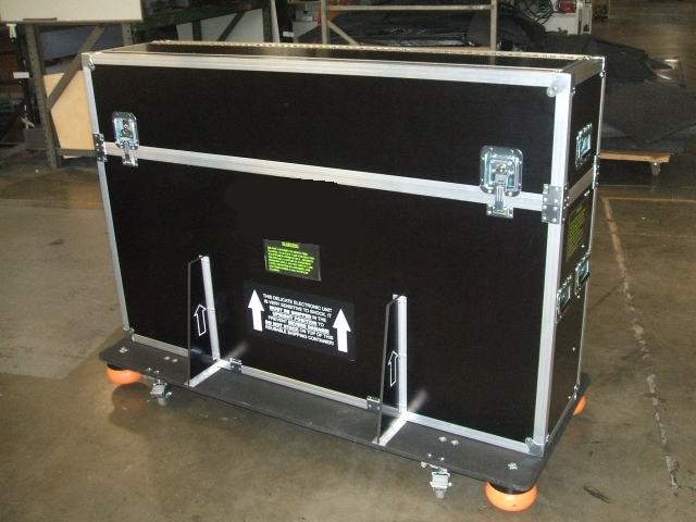 Print # 5315 - Custom lift case for Panasonic Th-65PF20U plasma with removable casters.  By Nelson Case Corp
