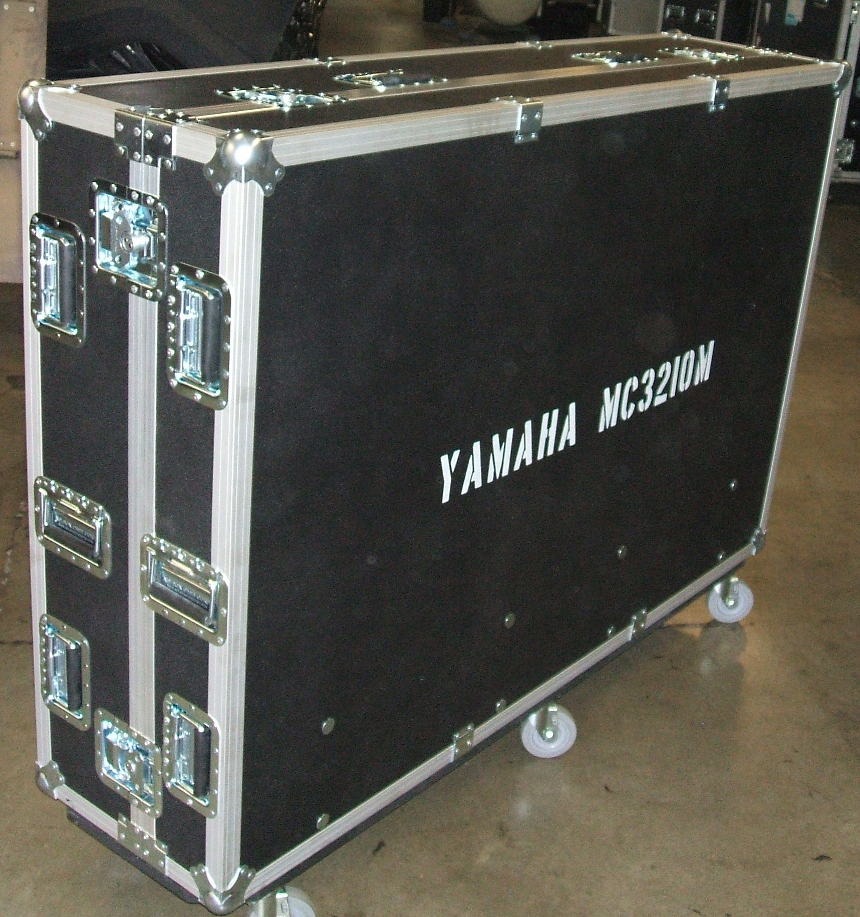 Print # 5629 - Custom Case for (1) Yamaha MC3210M Monitor Console Which Includes Heavy Duty Hardware, Heavy Duty Double Angle Aluminum Extrusion, Pop Off Cover, 8 Inch Dog house, 4 Inch Casters, 3/8 Black ABS  By Nelson Case Corp